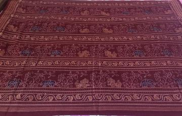 Elephant and lion Motifs all over ikat Cotton Fabric