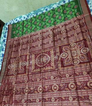 Exclusively woven Parrot and Lotus Motifs Double Ikat Silk Saree with blouse Piece