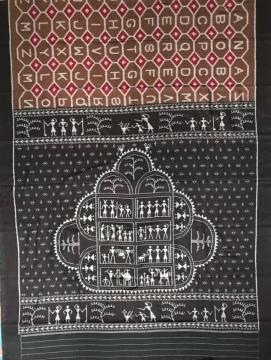 Intricately woven English alphabets all over body with tribal aanchal Cotton Ikat Saree with Blouse