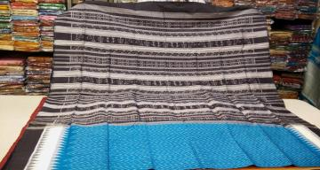 Copper Sulphate and Black Tribal work Aanchal all over Ikat work SIlk Saree